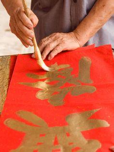 writing chinese new year's greeting...
