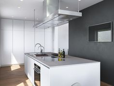 Even the range hood and faucets forgo extraneous detail. The kitchen island is smooth and glossy – only the worktop hints at pattern or texture to match the matte wall behind it.