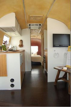 Zen style Airstream  Karen - LOVE, the clean lines, the lightness of it, the open ness even tho it is off set somewhat, yup one of my faves, the colour of the ceiling too, looks sponged on, this should be at the mid to aft with bdrm at aft, then bathroom or masterbdrm with ensuite mebbe, then from galley forward all open, no more dividers, but curtain or pony wall at back of drivers seat