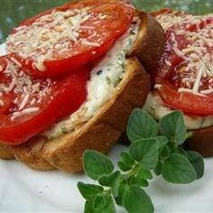 Fresh, ripe tomatoes are marinated in olive oil and balsamic vinegar, then broiled with Parmesan cheese on toast.  Serve warm with a bowl of soup, if desired.
