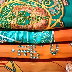 I love scarves. What an easy way to change your style with the same basic clothing pieces.   Hermes scarfs
