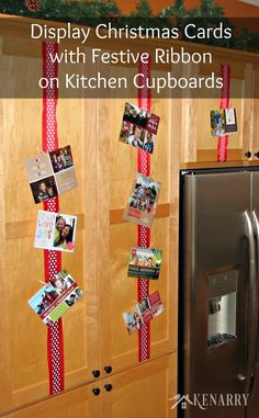 LOVE this idea! Display Christmas cards with ribbon on your kitchen cabinets so you can enjoy looking at them throughout the holidays. Ideas for displaying Christmas cards.