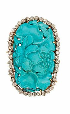 Two-Color Gold, Carved Turquoise and Diamond Brooch 18 kt. white yellow gold, one carved turquoise ap. 22.0 x 37.0 mm., rose-cut diamonds.
