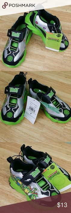 Teenage Mutant Ninja Turtles Toddler Boy's Sneaker TMNT Teenage Mutant Ninja Turtles Toddler Boy's Sneakers, color Green with black, size 7,  padded footbed and padded tongue, mesh/EVA lining, simple to put on and take off, synthetic pu upper, astener closure, $20.00 store retail price value, comes new with tag as closeout item in good cosmetic condition. Nikelodeon Shoes Sneakers