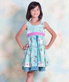 As bright and bold as a butterfly, this cotton frock is full of color and cheer. Featuring a sunshiny print and bow in back, it's ever ready for a flight of fancy.