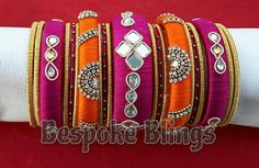 orange and pink combo silk thread bangles(mirrors and springs)