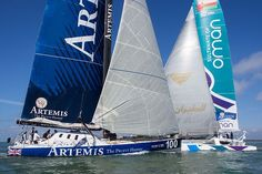 The IMOCA 60 yacht 'Artemis Ocean Racing II and the MOD 70 trimaran 'Musandam - Oman Sail' competing in the Artemis Challenge during Cowes Week 2014.: