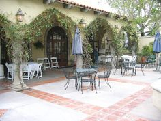 Courtyard patio,s should have room for guests, an outdoor kitchen, fire pit, water feature, garden...