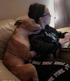 Kayla Filoon shared the adorable photo of her dog, Russ, cuddling her. She told the Dodo: ...