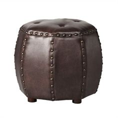 This octagon accent ottoman with its bonded leather and overscalled brass nail heads, makes for the perfect accent to put your feet up on or display in pairs as a great cocktail table design.