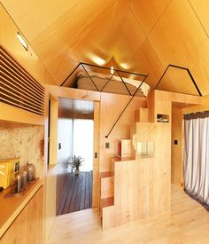 This tiny house is located in Gangwon city, one of the cleanest areas in Korea. It is also the host city for the upcoming Pyeongchang 2018 Olympic Winter Games. The area's clean environment demands for careful planning and architectural designs that will preserve the natural beauty of its' surroundings. 'The Tiny House Of Slow Town' is a project by DNC Architects and The Plus Partners,
