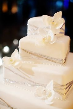 beautiful wedding cake... But with silver and blue ribbon