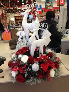 Silver deer with red poinsettias and roses and white roses