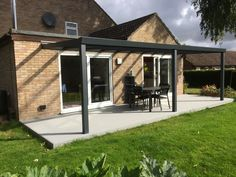 Aspire glass roof veranda from SunSpaces. Modern veranda design - perfect for outdoor relaxation! Request your FREE veranda quote today. Timbertech Decking, Plastic Decking, Outdoor Spaces, Outdoor Decor, Composite Decking, Glass Roof, Relax, Ash, Modern