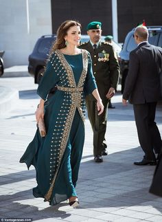 Rania strides forth in her heels at the event which took place at the Al Rayah parade grou...