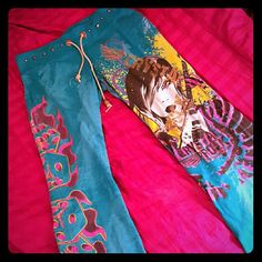 CRYSTAL ROCK teal bootcut pants SZ XS Crystal Rock by crystal audigier teal bootcut pants with  cool graffics. Size xs. These are super unique and fun! They have gold studs on the waist & gold drawstring as well as other cool tattoo inspired artwork. One of the gold beads is missing on 1 of the drawstrings.. please see 2nd picture. Other then  that good condition. Make an offer! crystal rock Pants Track Pants & Joggers