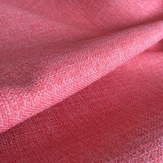 A coral pink upholstery fabric with a slubbed texture.Suitable for all upholstery projects, pillows, cushions, some window treatments and other home decor pro