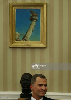 King Felipe VI of Spain listens to US President Barack Obama speak during a bilateral meeting in the Oval Office at the White House September 15, 2015 in Washington, DC. King Felipe VI and Queen Letizia are visiting Washington in an effort to reinforce the American-Spanish relationship.