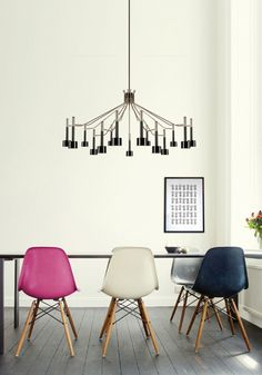 chandelier & Eames chairs with wood bases
