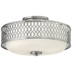 Highlighted by a tri-level pattern of repeating circles, the Jules Flushmount is, well, not so flush. A ceiling canopy creates a slightly stepped drop from the top, and we approve. With a Brushed Nickel screened veneer complemented by a small bottom finial, the Jules Flushmount is a soft deco lighting solution suited for transitional interiors.
