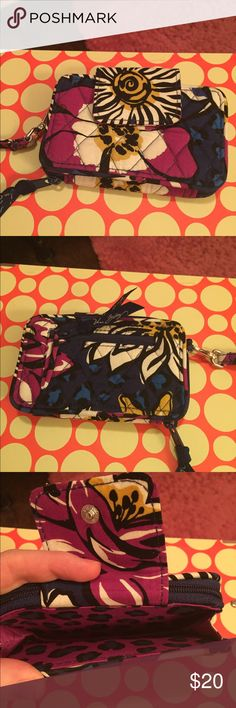 Vera Bradley Smartphone Wristlet 2.0 (Pattern: African Violet)          Never used; great condition! Too small for iPhone 6 ( fits IPhone 5 with otter box); magnetic front pocket for phone, zipper wallet compartment on back with card slots, ID window, zipper on back for coins, etc. Vera Bradley Bags Clutches & Wristlets