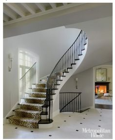 This staircase will lead down into the man cave, minus the white paint and animal print carpet.