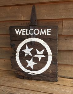 "SOLD! This old barn door just made me swoon and was chunky and just plain perfect for this sign. We gathered this small barn door from our Tennessee farm and stained it and hand painted welcome and finished off with our state tristar. The rusty old hinge makes the perfect hanger for displaying indoors or outside. Size is 20""x22"". Only one available online at www.signniche.com"