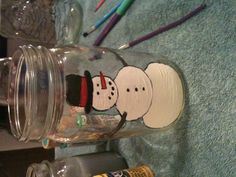 Hand painted mason jar snowman perfect gifts for Christmas on a tight budget
