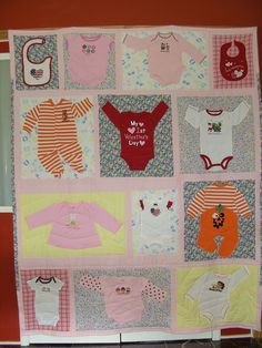 Baby quilt made out of baby cloths.