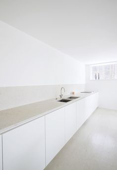 White Minimal Kitchen    HOUSE O,     2009, Kronberg, Germany - I love the simple, white minimalism and the cupboard doors.