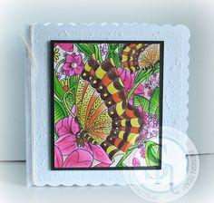 Designed by Gaynor Greaves - watercolour card - black card - textures snow embossing folder - Spectrum Noir sparkle pens Moonlight - Inspired Violet - Cosmos - Rose Quartz - Pink Garnet - Harvest Moon - Smoked Quartz - Emerald green - Holly leaf - Sand dune #spectrumnoir #sparkle #butterfly #handmade #craft