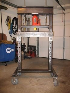 Shop Press - Homemade shop press constructed from C-channel, square and rectangular tubing, steel plate, round bar, and nylon. Powered by a bottle jack. Metal Workshop, Garage Workshop, Garage Tools, Diy Garage, Metal Fabrication Tools, Shop Press, Garage Atelier, Metal Shaping, Press Brake