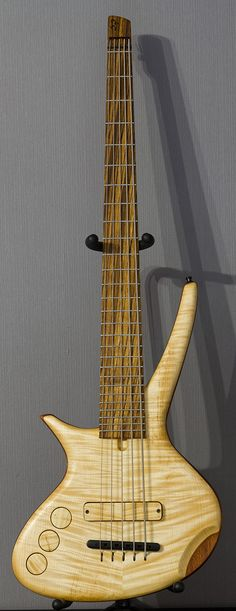 """Orchid, 5 strings lefty. 27 frets. flamed maple top, mahogany body, maple neck and zebrano fretboard. new """"headstock"""" design. tung oil finish. www.cg-lutherie.net"""