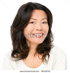 Asian woman smiling happy portrait. Beautiful mature middle aged Chinese Asian woman closeup beauty portrait isolated on white background. - stock photo