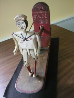 "Sailor dancing figure, c.1937. On wood platform with hammer to activate. Named on back plate ""Can Do"". Underneath base ""1937 Mfg. by A.W. Edwards, Chatham"". Normally housed in the Joseph C. Lincoln Room at Atwood House Museum"