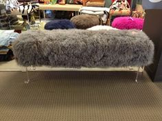 I loved this Mongolian lamb's wool bench from Outpost Original that seemingly floats in space, courtesy of clear acrylic legs.