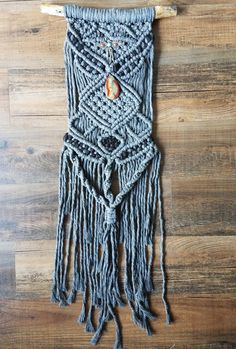 """This is a macrame and weaving, also known as """"macra-weave"""". The macrame was made using 100% natural cotton rope in gray by MacuNana"""