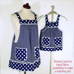 Lovely navy blue polka dot Pinafore Apron which is designed to be easy to put on and take off-- with no ties, buttons, or fasteners of any kind. Simply slip the apron over your head like a t-shirt and slide your arms into the generous openings to put it on. Apron rests totally on the