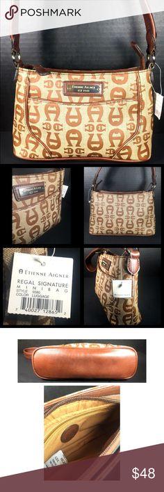 "Etienne Aigner NWT Mini Handbag Etienne Aigner NWT Mini Handbag in Brown Signature Jacquard.  10X6X3"" W/8.5"" SD.  Perfect condition. NWT  Orig. $120.00. Etienne Aigner Bags Mini Bags"