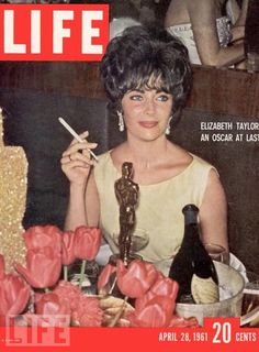 The cover of Life magazine features a photograph Britishborn American actress Elizabeth Taylor a smile on her face as she smokes a cigarette at a postAcademy Award party an Oscar statuette on the. Life Magazine, Magazine Cover Page, Movie Magazine, Ebony Magazine Cover, Magazine Stand, Star Magazine, History Magazine, People Magazine, Magazine Art