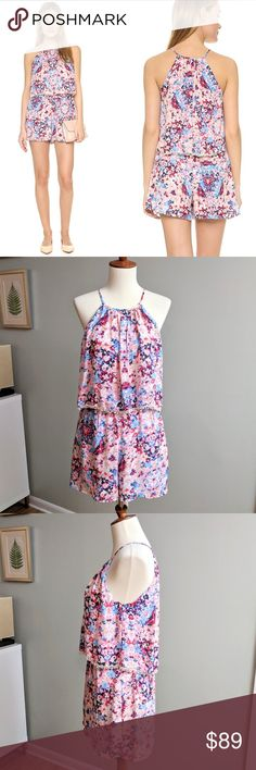 Parker Catamaran Romper Floaty silk romper in a floral print trimmed in a tiny pom accent. Fluttering overlay bodice conceals hidden zipper. Pockets at hips. Size XS. Excellent condition. Parker Pants Jumpsuits & Rompers