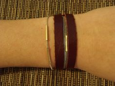 Deep red leather warp bracelet with silver chain and gold tube beads. $14.95, via Etsy.