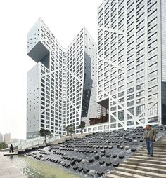 Sliced Porosity Block - Chengdu, China;  a city block of five unusually shaped towers with offices, apartments, retail, and restaurants;  designed by Steven Holl Architects;  photo by Hufton + Crow