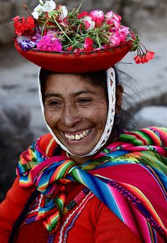 Women in Peru with flower basket