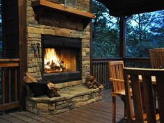 Outdoor Covered Dining Next to Stone Fireplace and Spectacular Views.