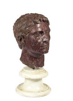 An Italian red porphyry head of a Roman emperor.