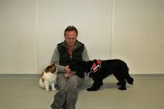 Colin Butcher with Molly and one of the cats which volunteered to help with her training. UKPD