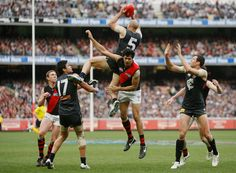 Chris takes a high mark over Patrick Ryder of Essendon during the 1st Elimination Final against Essendon at the MCG in 2011.