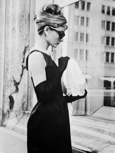 """Hubert Givenchy helped to define the 1960s refined style by dressing its most elegant actress, Audrey Hepburn, both on screen and off. Givenchy's designs were used in Hepburn movies such as Charade, Paris When it Sizzles, How to Steal a Million, and of course, Breakfast at Tiffany's, for which he designed the most famous """"Little Black Dress"""" of all time."""