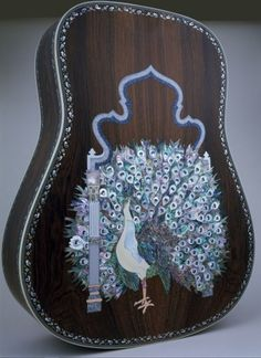 Peacock with feathers spread out far and wide-- more than the real bird has, by the way! But still a lovely Martin Guitar Back by Larry Robinson, Robinson Custom Inlays, Valley Ford, California. Pinned via any time blues / UNPLUGGED. Guitar Inlay, Guitar Art, Music Guitar, Playing Guitar, Unique Guitars, Custom Guitars, Resonator Guitar, Cigar Box Guitar, Mandolin